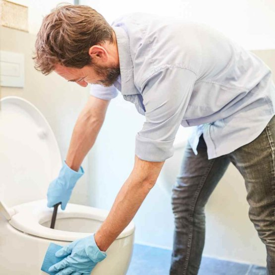 men_cleaning_toilet_bowl.jpeg
